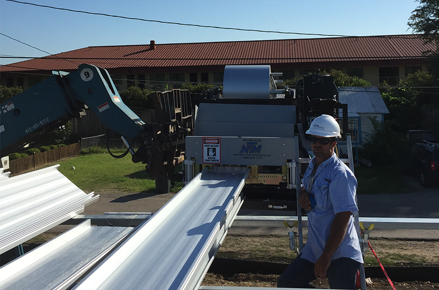 panel exiting portable roof panel machine