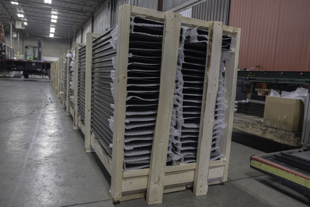 metal panels in crate for delivery to site