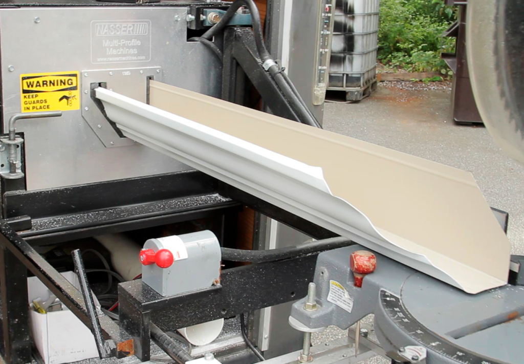 gutter coming out of exit end of portable gutter machine