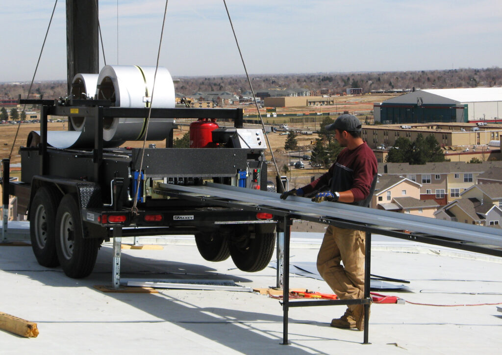 portable roof panel machine on top of roof